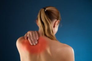 female upper back pain treated by chiropractor
