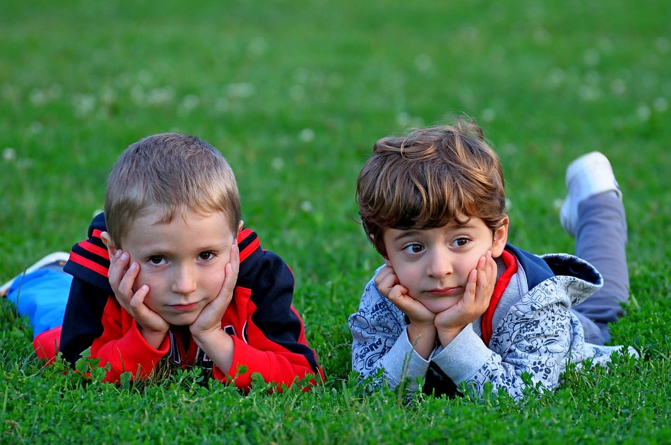 children lying in grass - do you need surgery